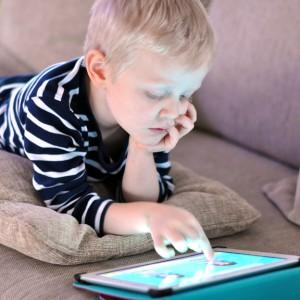 lazy kid with an ipad