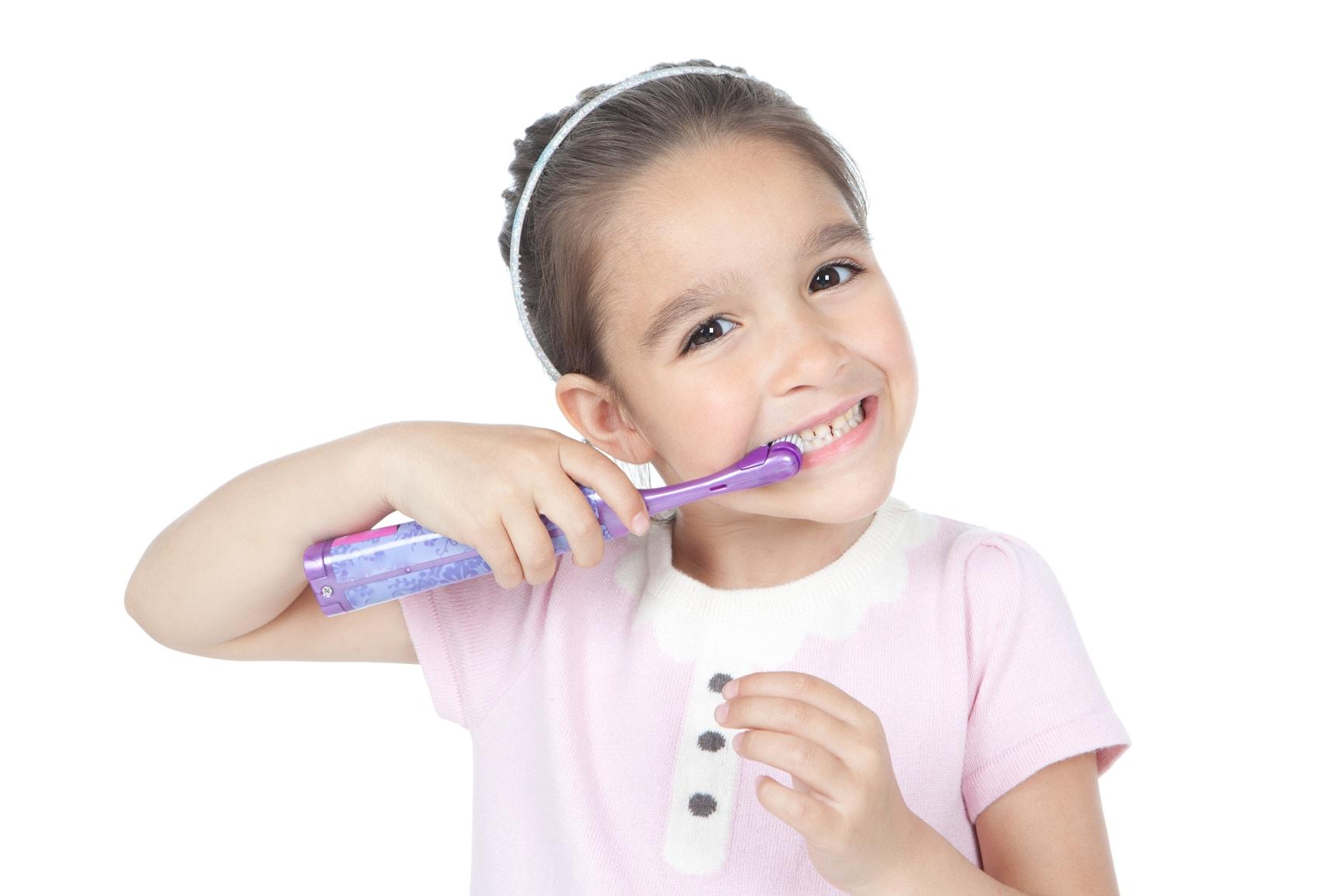 girl brushing teeth